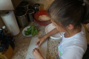 Emma working at assembling her layered ingredients.