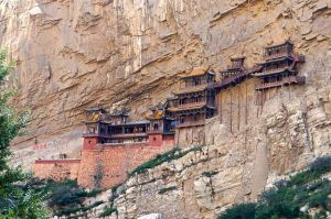 The Hanging Monastery appears to cling to the rock face.