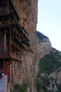 The Monastery is supported by 3 meter long oak beams inserted horizontally into the rock face. The vertical pillars don't lend much support and most can be moved by hand.