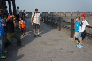 Jacob posing with a boy on the city wall of Pingyao.