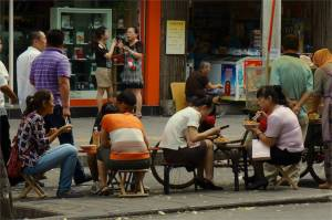 Mini tables and chairs along the street seem to be the norm here.