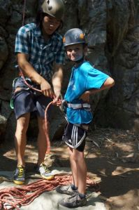 Abond is getting Jacob ready for a climb and making sure that the A-G checklist is done.
