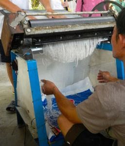 This is how they cut the rice paper into noodles called vermicelli.