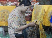 A woman creating batik
