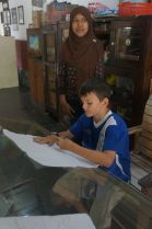 Jacob creating his sketch for his batik