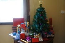 Presents under, er... beside the tree