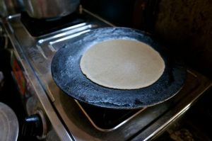 Fry the chapati on a hot griddle.  Flip to brown both sides.