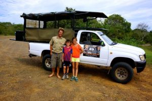 Our tour guide, Ranger Rick, with Emma and Jacob.  All set to go.