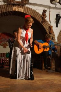 Lady using castanets in Flamenco dancing. As you can see she is not just using her hand to make the noise.